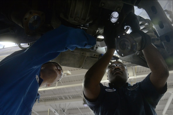Airman 1st Class Joshua Byers, 341st Logistics Readiness Squadron vehicle mechanic, left, and Staff Sgt. Willie Hatcher, 341st LRS firetruck and refueler maintenance apprentice, examine the underside of a Humvee April 12, 2019, at Malmstrom Air Force Base, Mont.
