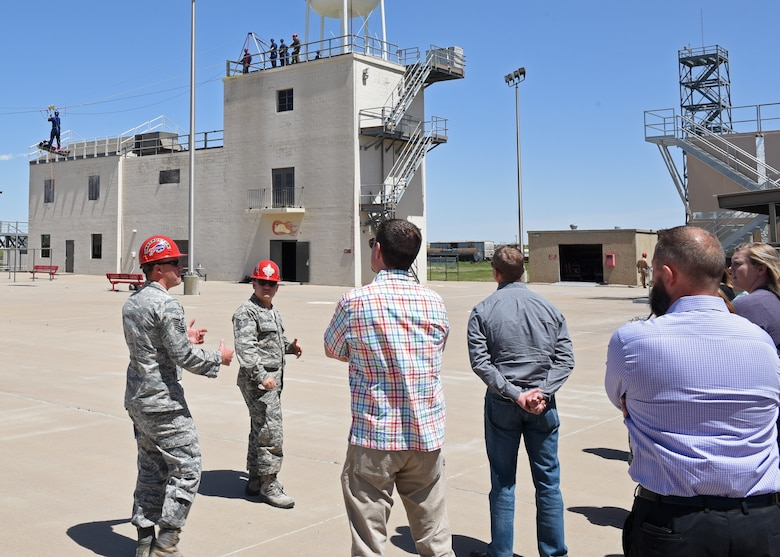 U.S. Air Force Tech. Sgt. Kyle Wirth, 312th Training Squadron instructor, along with Tech. Sgt. Joshua Leonida, 312th TRS instructor, give the Leadership San Angelo class a tour of the Louis F. Garland Department of Defense Fire Academy on Goodfellow Air Force Base, Texas, April 11, 2019. During the tour of the Fire Academy guests were able to see the different branches working together to learn the skills needed to fight any fire threat they may face. (U.S. Air Force photo by Airman 1st Class Zachary Chapman/Released)