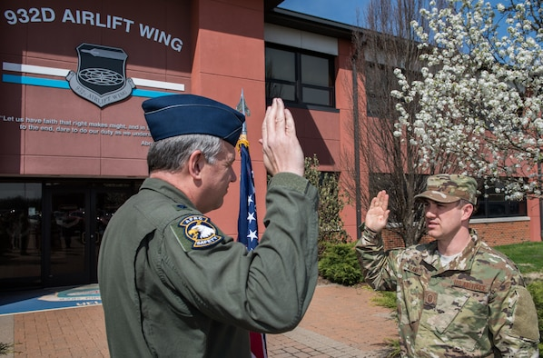 Master Sgt. Eric Adams, 932nd Airlift Wing flight safety noncommissioned officer in charge, recites the Oath of Enlistment, given to him by Lt. Col. Mike Louer, 932nd AW chief of safety, April 7, 2019, Scott Air Force Base, Illinois.  (U.S. Air Force photo by Master Sgt. Christopher Parr)