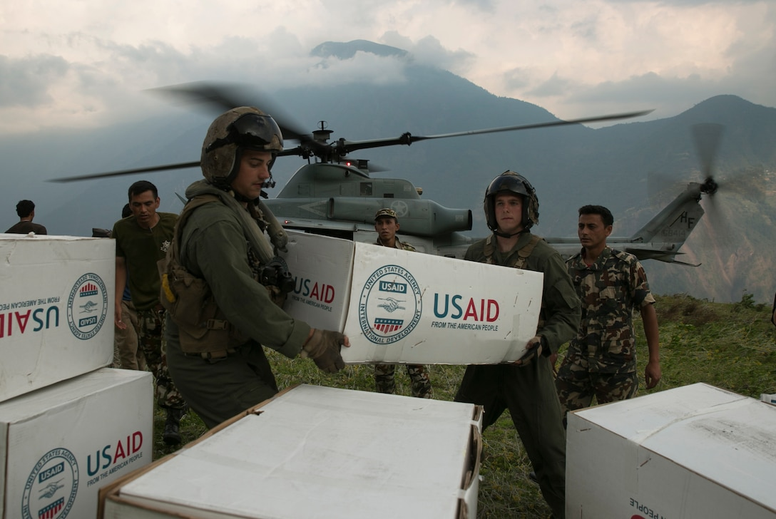 Troops hand off USAID boxes
