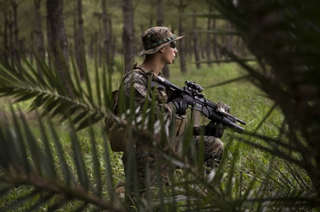A U.S. Marine with Special Purpose Marine Air-Ground Task Force-Crisis Response-Africa 19.2, Marine Forces Europe and Africa, posts security during patrol training aboard Morόn Air Base, Spain, April 9, 2019. SPMAGTF-CR-AF is deployed to conduct crisis-response and theater-security operations in Africa and promote regional stability by conducting military-to-military training exercises throughout Europe and Africa. (U.S. Marine Corps photo by Cpl. Margaret Gale)