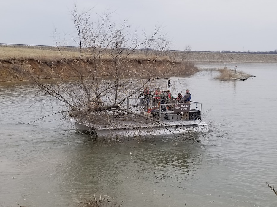 Volunteers along with USACE, MDC, Clay County Parks, and Burton's Bait & Tackle sunk trees into Smithville Lake for fish habitat in their 9th Annual event.  F.I.S.H. stands for Friends Improving Smithville Habitat. 