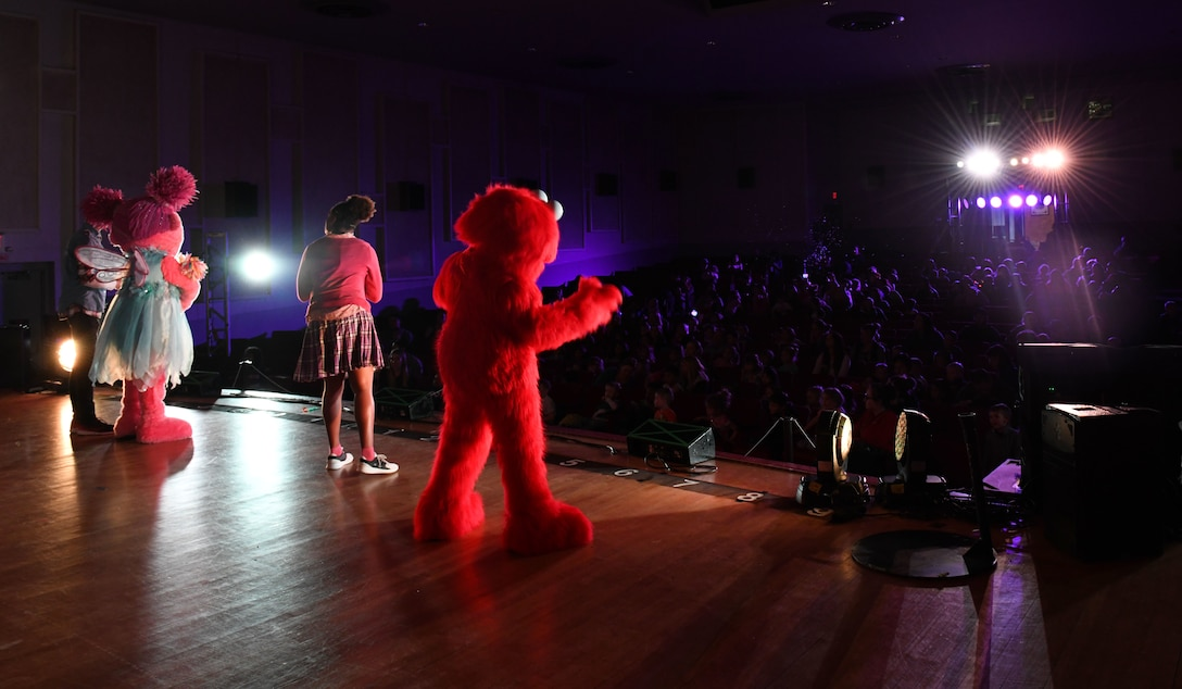 Character from Sesame Street Live sing and dance for families at the base theater on Ellsworth Air Force Base, S.D., March 28, 2019. Families were able to get up close and personal with their favorite characters while singing, dancing and learning about the importance of community.  (U.S. Air Force photo by Airman 1st Class Christina Bennett)