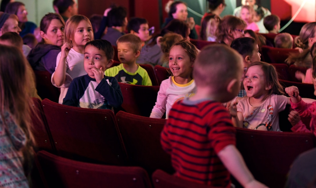 Children cheer during the finale of the Sesame Street Live performance held at the base theater on Ellsworth Air Force Base, S.D., March 28, 2019. Families were able to get up close and personal with their favorite characters while singing, dancing and learning about the importance of community. (U.S. Air Force photo by Airman 1st Class Christina Bennett)