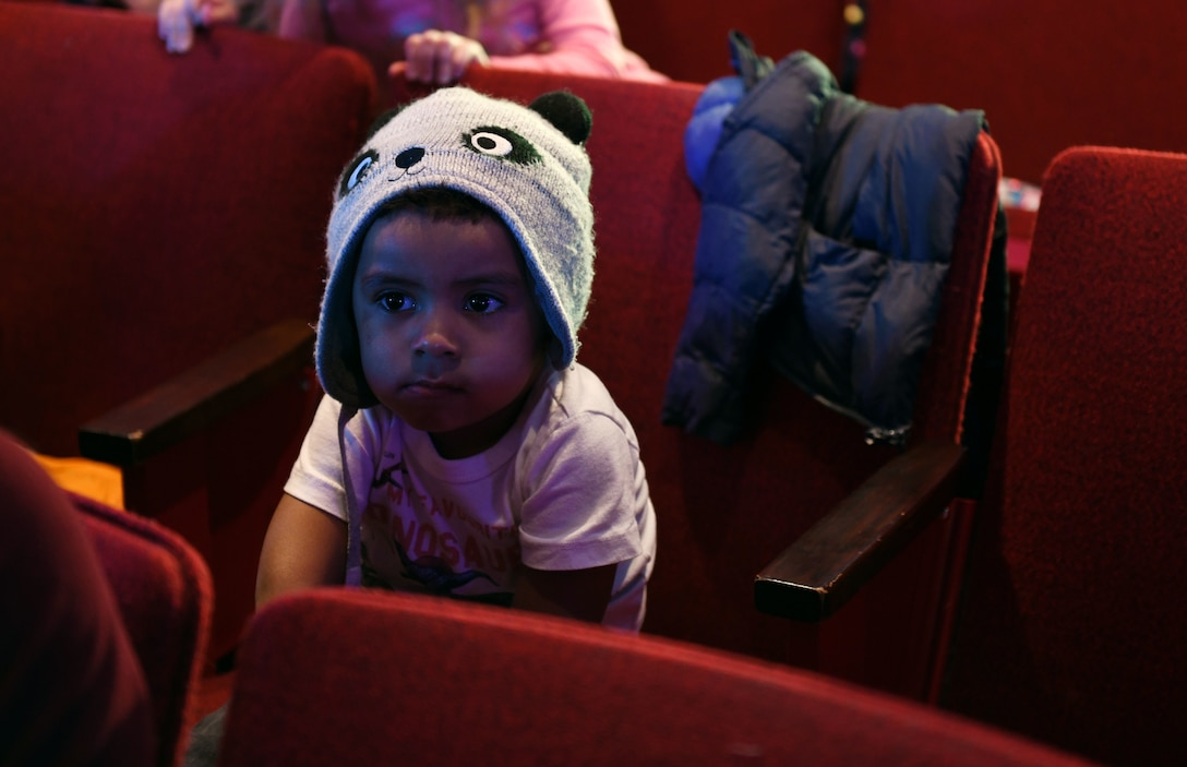 Jonathan Vazquez Jr., the son of Airman 1st Class Christina Bennett, a 28th Bomb Wing Public Affairs photojournalist, waits for Sesame Street Live to begin at the base theater on Ellsworth Air Force Base, S.D., March 28, 2019. Families were able to get up close and personal with their favorite characters while singing, dancing and learning about the importance of community. (U.S. Air Force photo by Airman 1st Class Christina Bennett)
