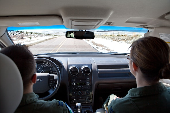 In this file photo, Capt. Aaron Alam, 321st Missile Squadron ICBM deputy combat crew commander, and Capt. Caitlin Olson, 321st Missile Squadron ICBM combat crew commander, drive through Nebraska to reach a missile alert facility. The TCF provides Airmen that trip out to the field updated weather and road conditions. (U.S. Air Force photo by 2nd Lt. Christen Downing)