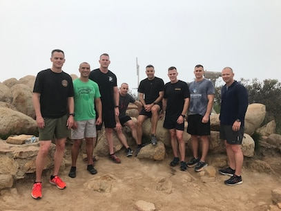 "The Recruiting Station commanders of ""Force 12"" run to the summit of Iron Mountain in Poway, Calif., during a District Commander's Operations & Training Symposium held April 12, 2019."