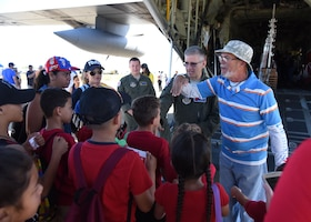 """Carlos A. Graulau, Puerto Rico Emergency Management Agency Zone 4 volunteer, translates for Lt. Col. Jeff Ragusa, Air Force Reserve 53rd Weather Reconnaissance Squadron pilot and aircraft commander, during the Caribbean Hurricane Awareness Tour at the Rafael Hernández Airport, Aguadilla, Puerto Rico, April 13, 2019. NOAA hurricane specialists and the U.S. Air Force Reserve Hurricane Hunters discussed hurricane preparedness, resilience and how they can become """"weather-ready"""" during the 2019 Caribbean Hurricane Awareness Tour April 8-13, 2019. As part of the event, dignitaries, students and the public toured the Air Force Reserve Command's WC-130J """"Hurricane Hunter"""" aircraft to learn how scientists collect hurricane information. (U.S. Air Force photo/Lt. Col. Marnee A.C. Losurdo)"""