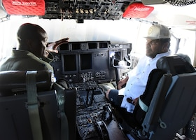 """Lt. Col. Darryl Woods, 53rd Weather Reconnaissance Squadron pilot, explains the Air Force Reserve Hurricane Hunter mission to Luis Guzmán, the Puerto Rican actor, during the Caribbean Hurricane Awareness Tour April 13, 2019, at the Rafael Hernández Airport, Aguadilla, Puerto Rico. NOAA hurricane specialists and the U.S. Air Force Reserve Hurricane Hunters discussed hurricane preparedness, resilience and how they can become """"weather-ready"""" during the event April 8-13, 2019. Dignitaries, students and the public toured the Air Force Reserve Command's WC-130J """"Hurricane Hunter"""" aircraft to learn how scientists collect hurricane information. (U.S. Air Force photo/Lt. Col. Marnee A.C. Losurdo)"""