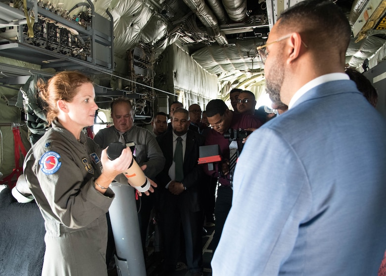 "Lt. Col. Kait Woods, 53rd Weather Reconnaissance Squadron aerial reconnaissance weather officer, explains the Air Force Reserve Hurricane Hunter mission to dignitaries at the Queen Beatrice International Airport, Aruba, during the 2019 Caribbean Hurricane Awareness Tour. During the event, the NOAA federal hurricane specialists and Reserve Citizen Airmen of the 53rd Weather Reconnaissance Squadron discussed hurricane preparedness, resilience and how they can become ""weather-ready."" As part of the event, dignitaries, students and the public toured the Air Force Reserve Command's WC-130J ""Hurricane Hunter"" aircraft to learn how scientists collect hurricane information. (U.S. Air Force photo/Lt. Col. Marnee A.C. Losurdo)"