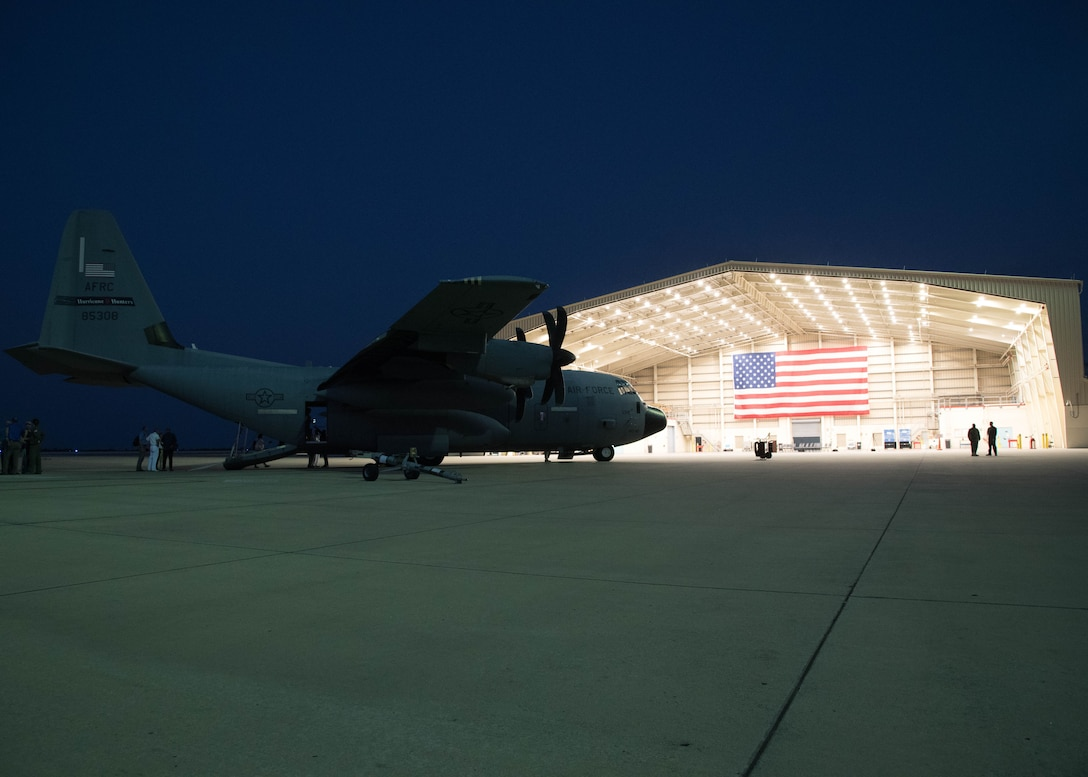 """An Air Force Reserve Command WC-130J Hercules sits on the flight line at the Curacao International Airport, Curacao, April 12, 2019. National Hurricane Center director Ken Graham, federal hurricane specialists, and Reserve Citizen Airmen of the 53rd Weather Reconnaissance Squadron, discussed hurricane preparedness, resilience and how community members can become """"weather-ready"""" as part of the Caribbean Hurricane Awareness Tour April 8-13, 2019. Tours of the WC-130J """"Hurricane Hunter"""" offered dignataries, students and members of the public an opportunity to learn how scientists collect hurricane information. The NOAA WP-3D aircraft, used for both hurricane forecasting and research, was on display as well. (U.S. Air Force photo/Lt. Col. Marnee A.C. Losurdo)"""