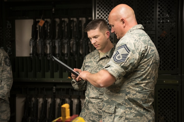 Senior Master Sgt. Brian L. Hobbs, the 124th Fighter Wing weapons safety manager, reviews a license with Senior Master Sgt. Chris Dorsten, the National Guard Bureau Weapons Safety Manager, during a weapons safety course at Gowen Field, Boise, Idaho, Sept. 11, 2018.