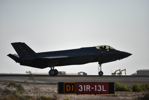 A photo of an F-35A Lightning II taxing down a runway