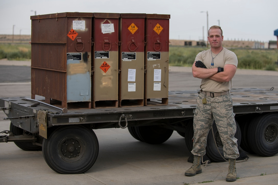 Airman 1st Class Isaac M. Campbell, a munitions systems apprentice from the 124th Maintenance Squadron, 124th Fighter Wing, stands next to boxes of 30 mm ammunition at Gowen Field, Idaho, Aug. 17, 2018.