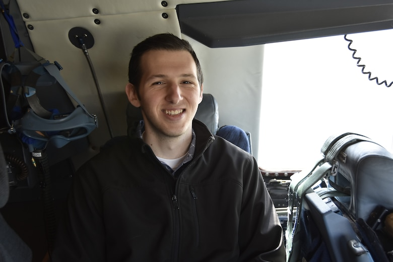 A civilian contractor from Hanscom Air Force Base, Massachusetts is all smiles aboard a C-5 Galaxy