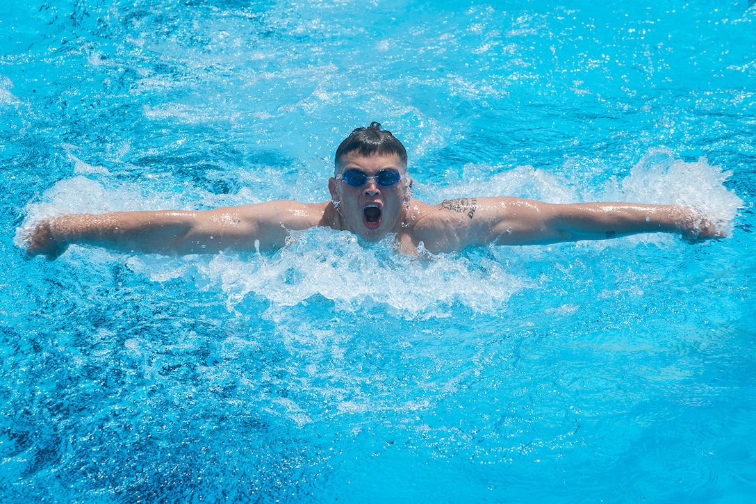 A Marine swims in a relay.