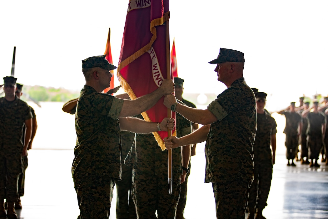 U.S. Marine Corps Maj. Gen. Bradley S. James, right, commander of Marine Forces Reserve, Marine Forces North and 4th Marine Aircraft Wing, passes the 4th MAW colors to Brig. Gen. Timothy L. Adams, member of the Marine Corps Reserve Policy Board, during the 4th MAW change of command ceremony at Naval Air Station Joint Reserve Base New Orleans, April 13, 2019. The ceremony was held to recognize the formal transfer of authority and responsibilities of 4th MAW from James to Adams. (U.S. Marine Corps photo by Lance Cpl. Jose Gonzalez)