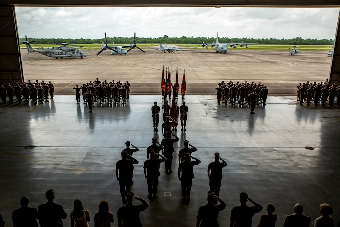 U.S. Marines with 4th Marine Aircraft Wing render honors during the 4th MAW change of command ceremony at Naval Air Station Joint Reserve Base New Orleans, April 13, 2019. The ceremony recognized Brig. Gen. Timothy L. Adams as the 43rd commanding general of 4th MAW. 4th MAW was activated 77 years ago on Aug. 22, 1942 at Ewa, Hawaii, as the 4th Marine Base Defense Aircraft Wing. (U.S. Marine Corps photo by Lance Cpl. Jose Gonzalez)