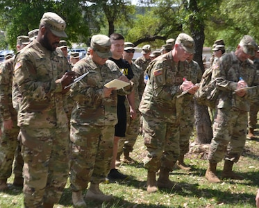 Members of the 549th Military Intelligence Battalion participate in an exercise in which they marched in place while answering questions at the same time. The exercise was one of several interactive activities service members participated in at a resiliency event on Joint Base San Antonio-Camp Bullis conducted by the Vogel Resiliency Center April 12.