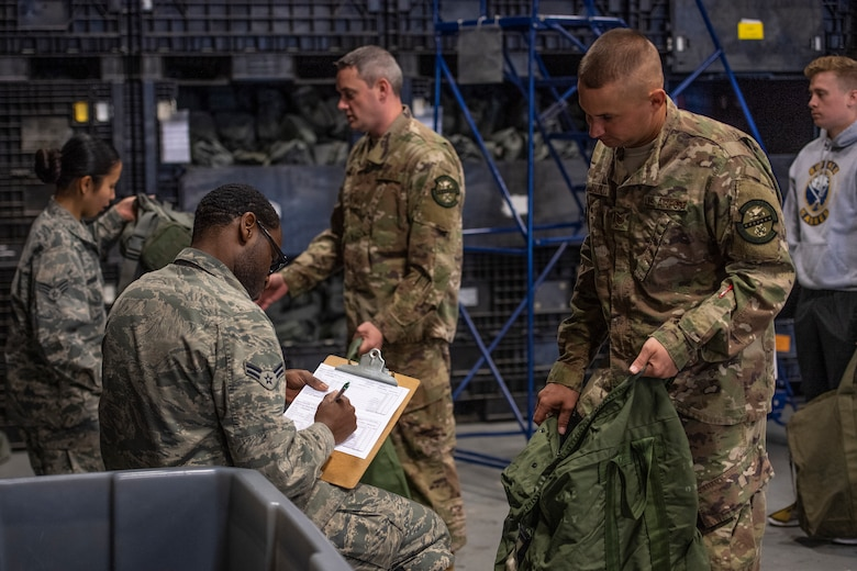 Airmen receive their MOPP gear April, 2, 2019, at Moody Air Force Base, Ga. From April 15-19, 2019, Moody executed a base-wide exercise that required players to function at a high operations tempo in a chemical, biological, radioactive and nuclear environment to meet Chief of Staff of the Air Force and the Commander of Air Combat Command's intent for readiness. (U.S. Air Force photo by Airman 1st Class Joseph P. Leveille)