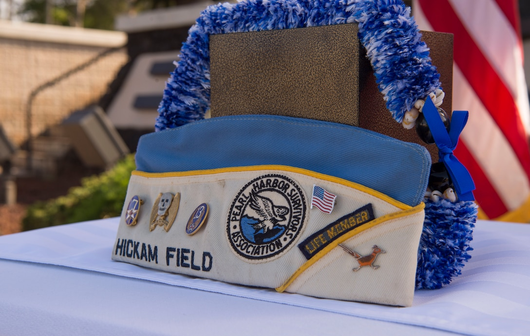 Retired Master Sgt. Byram Bates' hat sits on display with his remains during a memorial service held for him, at the Missing Man Memorial on Joint Base Pearl Harbor-Hickam, Hawaii, April 12, 2019. Bate's remains were turned over to Jessie Higa, a Hickam Field historian, by a family friend in Nov. 2018 as part of Bate's final wishes to be returned to Hawaii. (U.S. Air Force photo by Tech. Sgt. Heather Redman)