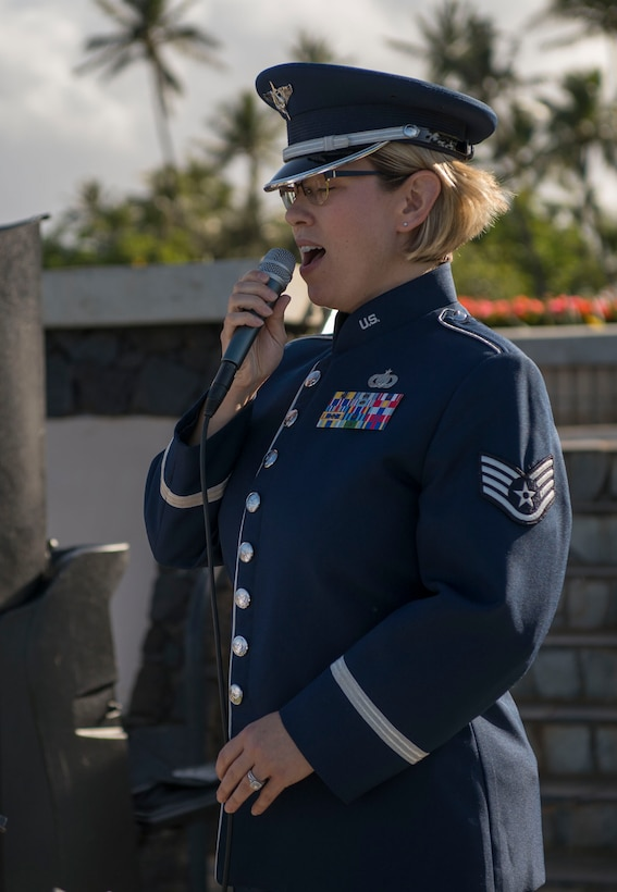Staff Sgt. Rachel Wilson, U.S. Air Force Band of the Pacific vocalist, sings the national anthem during a memorial service held for retired Master Sgt. Byram Bates at the Missing Man Memorial on Joint Base Pearl Harbor-Hickam, Hawaii, April 12, 2019. Bates enlisted in the Army Air Forces in 1940 and was stationed at Hickam Field during the attack on Dec. 7, 1941. (U.S. Air Force photo by Tech. Sgt. Heather Redman)
