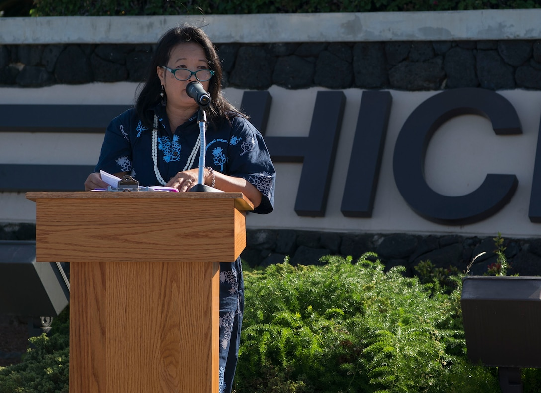 Jessie Higa, a Hickam Field historian, expresses the importance of remembering the past during a memorial service held for retired Master Sgt. Byram Bates at the Missing Man Memorial on Joint Base Pearl Harbor-Hickam, Hawaii, April 12, 2019. Bates was a survivor of the attack on Dec. 7, 1941, and was an active member of the Pearl Harbor Survivors Association until his death in 2007. (U.S. Air Force photo by Tech. Sgt. Heather Redman)