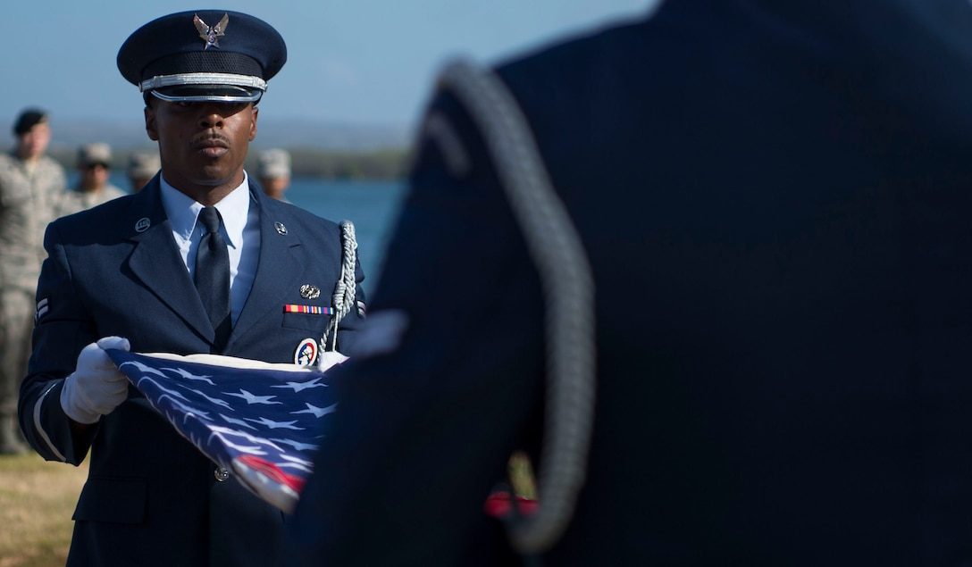 The 15th Wing Honor Guard performs a flag folding ceremony during a memorial service held for retired Master Sgt. Byram Bates at the Missing Man Memorial on Joint Base Pearl Harbor-Hickam, Hawaii, April 12, 2019. Bates was stationed at Hickam Field during the attack on Dec. 7, 1941, and went on to serve in the Pacific war front with the Army Air Forces in Eastern Mandates, Guadalcanal, Guam, Palau, Luzon, and the Southern Philippines. (U.S. Air Force photo by Tech. Sgt. Heather Redman)
