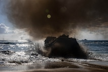 A U.S. Marine Corps amphibious assault vehicle assigned to Combat Assault Company, 3d Marine Regiment, moves into the ocean for a long range swim starting at Marine Corps Base Hawaii to Marine Corps Training Area Bellows, Apr. 5, 2019. The unit completed a three mile swim to improve their lethality and readiness as a mechanized unit prior to upcoming training events. (U.S. Marine Corps photo by Sgt. Jesus Sepulveda Torres)