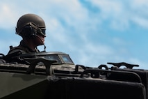 A U.S. Marine with Combat Assault Company, 3d Marine Regiment, prepares to operate an amphibious assault vehicle prior to conducting a beach assault exercise at Marine Corps Training Area Bellows, Marine Corps Base Hawaii, Apr. 9, 2019. The unit conducted a simulated beach assault to improve their lethality and cooperation, as a mechanized unit and force in readiness. (U.S. Marine Corps photo by Sgt. Alex Kouns)