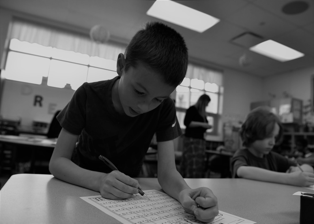 Reagan works on a math paper at school, April 15, 2019, in Cheyenne, Wyo. Reagan has adapted to the life of a military child. Purple is the color of the month of the military child, family and friends of military kids wear purple to show their support of the sacrifices and difficulties they face. (U.S. Air Force photo by Airman 1st Class Braydon Williams)