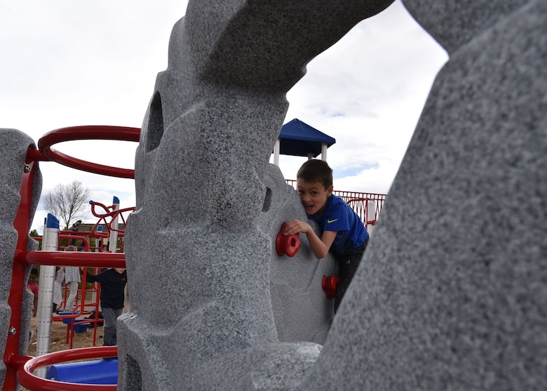 Reagan plays on a rock wall during recess, April 15, 2019, in Cheyenne, Wyo. Since 9/11, more than two million children have had a parent deploy, the moth of the military child is used as a time to recognize the difficulties kids face during those times. (U.S. Air Force photo by Airman 1st Class Braydon Williams)