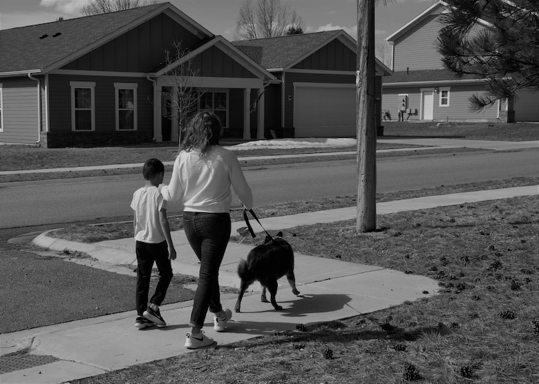 Airman 1st Class Megan Melvin, 90th Communications Squadron knowledge operations, and her son, Reagan walk home with their dog toby, April 6, 2019, on F.E. Warren Air Force Base, Wyo. The life of a military kid isn't easy but they always make the best of what they have, the Month of The Military Child gives military children the chance look at their own life and talk about what they face as a military child. (U.S. Air Force photo by Airman 1st Class Braydon Williams)