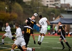 NAVAL STATION EVERETT, Wa. (April 14, 2019) - Players from the Army and Navy soccer teams compete in the opening match of the Armed Forces Sports Men's Soccer Championship hosted at Naval Station Everett. (U.S. Navy Photo by Mass Communication Specialist 2nd Class Ian Carver/RELEASED). 190414-N-XK513-1438