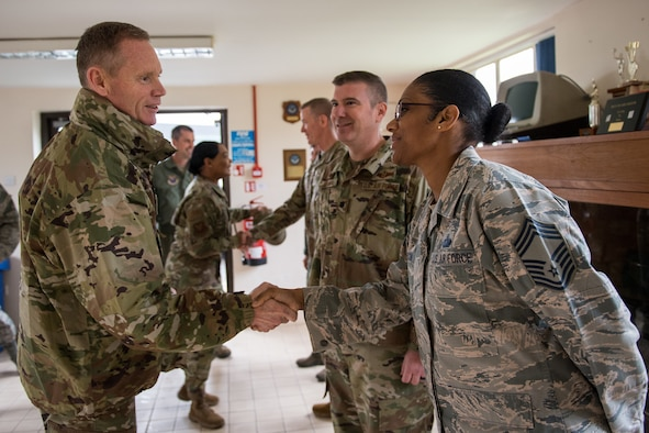 Maj. Gen. James Dawkins Jr., Eighth Air Force and Joint-Global Strike Operations Center commander, shakes hands with Chief Master Sgt. Christy Peterson, Bomber Task Force Mission Support Group superintendent deployed from Barksdale Air Force Base, La., after his arrival at RAF Fairford, England, April 4, 2019. Dawkins visited the base during a U.S. Strategic Command Bomber Task Force in Europe. (U.S. Air Force photo by Airman 1st Class Tessa B. Corrick)
