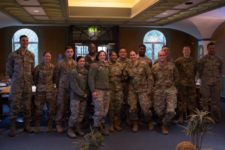Airmen deployed from Barksdale Air Force Base, La., pose for a photo with Chief Master Sgt. Melvina Smith, Eighth Air Force command chief, at RAF Fairford, England, April 4, 2019. The group of Airmen were selected to have lunch with Smith during her visit to the base. (U.S. Air Force photo by Airman 1st Class Tessa B. Corrick)