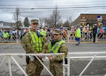 Spc. Daniel Dellisola and Pvt. Haley MacDonald, 747th Military Police Company Soldiers, support state and local law enforcement during the 123rd Boston Marathon April 15, 2019, in Hopkinton, Massachusetts. More than 500 members of the Massachusetts National Guard provided support during the marathon.
