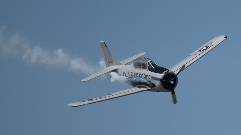A pilot for the Trojan Thunder T-28 aerial demonstration team performs over the Ohio River during the annual Thunder Over Louisville airshow in Louisville, Ky., April 13, 2019. Hundreds of thousands of spectators turned out to view the event, which has grown to become one of the largest single-day air shows in North America. (U.S. Air National Guard photo by Dale Greer)