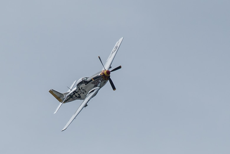 Swamp Fox, a P-51 Mustang aircraft flown by R.T. Dickson, performs an aerial demonstration April 13, 2019, in the annual Thunder Over Louisville airshow in Louisville, Ky. This exact aircraft, now restored, was once assigned to the Kentucky Air National Guard more than 60 years ago when the unit's mission was aerial defense. (U.S. Air National Guard photo by Dale Greer)