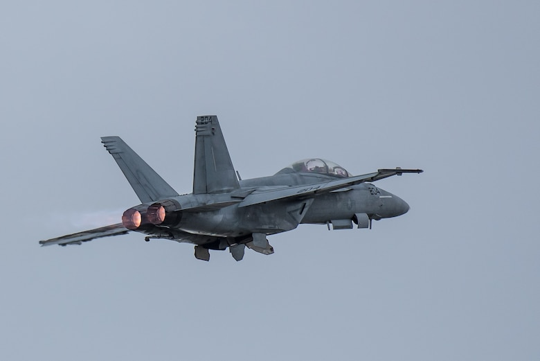 An F/A-18 Super Hornet from the U.S. Navy's Tactical Demonstration Team, Strike Fighter Squadron 106, Naval Air Station Oceana, Va., streaks over the Ohio River during the Thunder Over Louisville airshow in Louisville, Ky., April 13, 2019. The Kentucky Air National Guard once again served as the base of operations for military aircraft participating in the annual event, which has grown to become one of the largest single-day air shows in North America. (U.S. Air National Guard photo by Dale Greer)