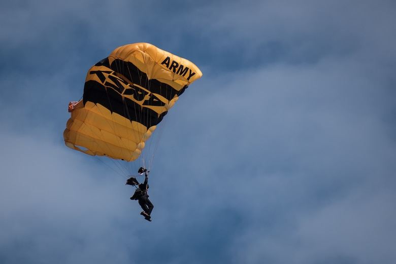 A soldier from the U.S. Army's Golden Knights parachute demonstration team descends into downtown Louisville April 13, 2019, during the annual Thunder Over Louisville air show. Hundreds of thousands of spectators turned out to view the event, which has grown to become one of the largest single-day air shows in North America. (U.S. Air National Guard photo by Dale Greer)