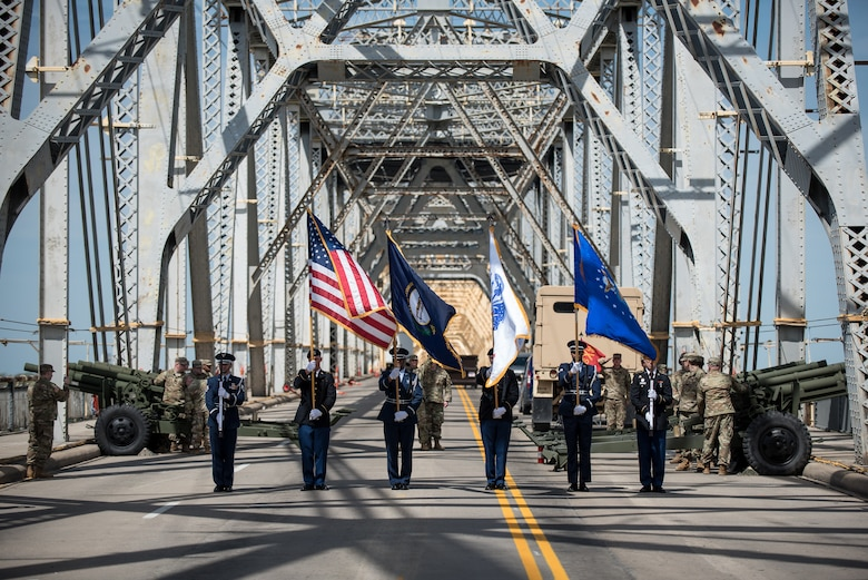 A joint color guard from the Kentucky Army and Air National Guard presents the colors to kick off the Thunder Over Louisville air show in downtown Louisville, Ky., April 13, 2019, as the Kentucky Guard's 138th Field Artillery Brigade stands buy to add cannon fire to the Star Spangled Banner. The annual event, which featured more than two dozen military aircraft, has grown to become one of the largest single-day air shows in North America. (U.S. Air National Guard photo by Dale Greer)
