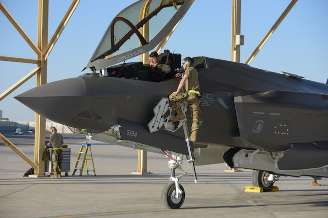 A 380th Air Expeditionary Maintenance Group crew chief meets an F-35A Lightning IIs pilot at Al Dhafra Air Base, United Arab Emirates, April 15, 2019. The F-35A Lightning II is deployed to the Air Forces Central Command Area of Responsibility for the first time in U.S. Air Force history. (U.S. Air Force photo by Staff Sgt. Chris Thornbury)