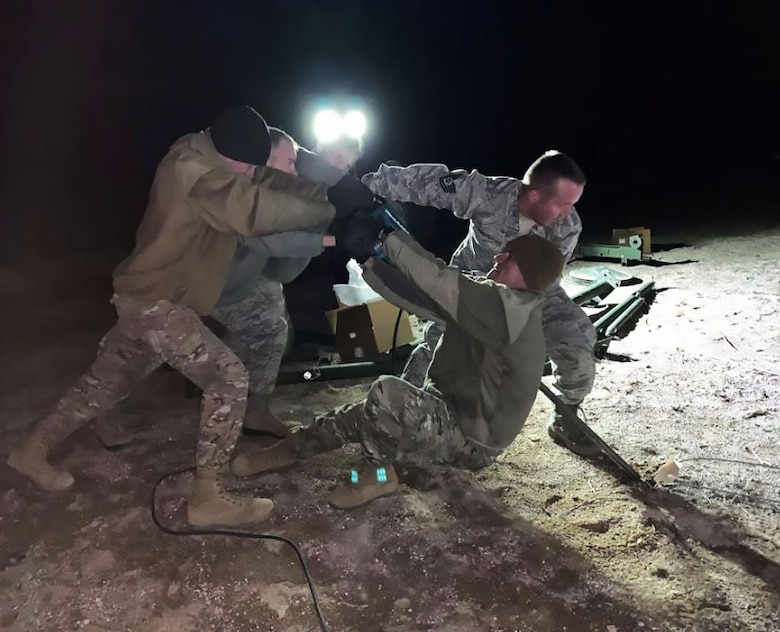 Airmen from the 726th Air Control Squadron drive 99 feet of copper grounding rods and 7,000 feet of electrical cabling into the Nevada soil in less than 72 hours. This preparation was needed to set up the Tactical Operations and Control and Reporting Centers so the TYQ-23A could be fully integrated at Red Flag 19-02. (Courtesy photo).