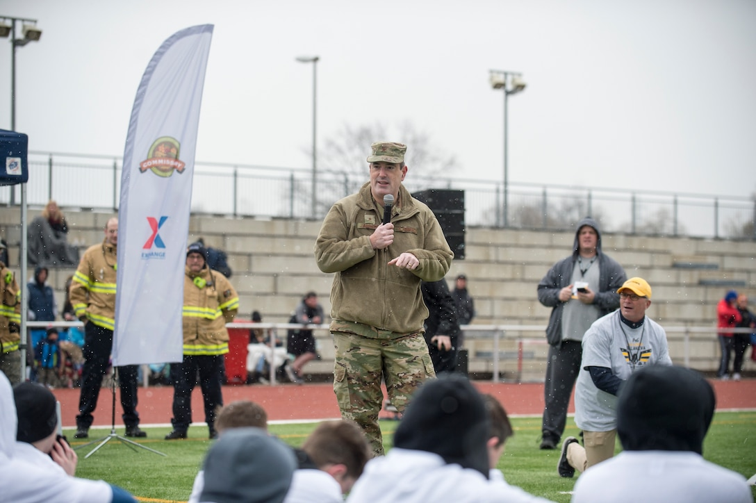 U.S. Air Force Brig. Gen. Mark R. August, 86th Airlift Wing commander, speaks to the Alejandro Villanueva football camp attendees before the camp begins at Kaiserslautern High School on Vogelweh Military Complex, April 13, 2019. August thanked Villanueva, Pittsburgh Steelers offensive lineman, and former U.S. Army captain and Army Ranger, for traveling to Europe to coach Kaiserslautern Military Community youth and adults. (U.S. Air Force photo by Staff Sgt. Jonathan Bass)
