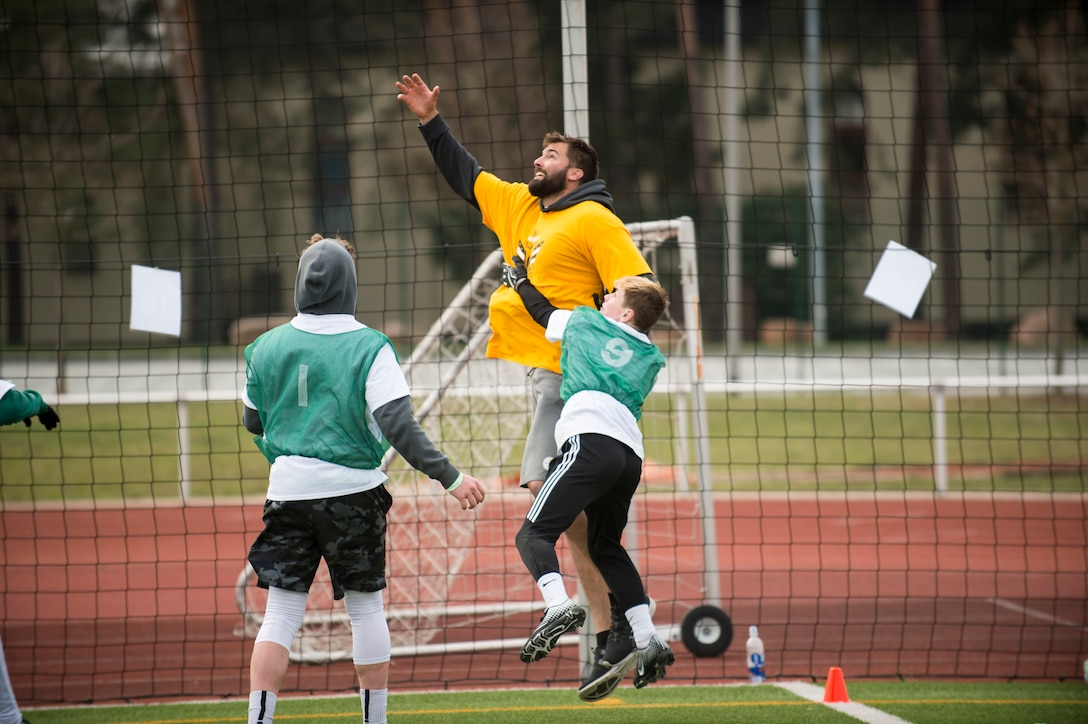 Alejandro Villanueva, Pittsburgh Steelers offensive lineman, jumps to catch a pass during a seven-on-seven football game during his youth football camp at Kaiserslautern High School on Vogelweh Military Complex, Germany, April 13, 2019. Villanueva, a former U.S. Army captain and Army Ranger, returned to Europe to host his first overseas football camp. (U.S. Air Force photo by Staff Sgt. Jonathan Bass)