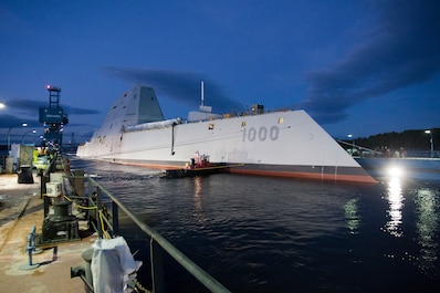 131028-O-ZZ999-102 BATH, Maine (Oct. 28, 2013) The Zumwalt-class guided-missile destroyer DDG 1000 is floated out of dry dock at the General Dynamics Bath Iron Works shipyard. The ship, the first of three Zumwalt-class destroyers, will provide independent forward presence and deterrence, support special operations forces and operate as part of joint and combined expeditionary forces. The lead ship and class are named in honor of former Chief of Naval Operations Adm. Elmo R.