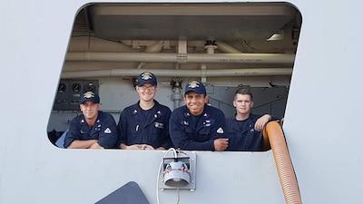 Zumwalt Sailors setting up hotel services.
