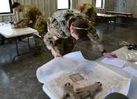 Soldiers competing at the Fort Knox 2019 Best Warrior competition April 8-12, 2019, are given one hour to answer over 90 questions focused on map reading. To add to the stress of the event, their time started as soon as they came off of a stress shoot event. The five-day competition covered 20 events designed to measure excellence is warrior tasks and skills.