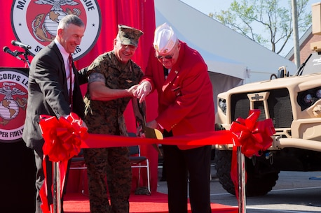 From left to right, Michael Regner, Director of Military Expos at the Marine Corps League, Lt. Gen. Robert F. Hedelund, II Marine Expeditionary Force commanding general and Wendell Webb, National Commandant of the Marine Corps League, participate in a ribbon cutting ceremony to celebrate the opening of Marine South Expo 19 at Camp Lejeune, N.C., April 11, 2019. Marine South is an annual military exposition that provides a first-hand look at the latest technology, products and prototypes from the world's leading defense equipment manufacturers. The products showcased during the event are aimed toward preparing Marines to overcome the challenges of the modern battlefield. The expo is sponsored by the Marine Corps League, a Marine Corps veterans' association, and co-sponsored by Marine Corps Base Camp Lejeune. (U.S. Marine Corps photo by Cpl. Leynard Kyle Plazo)